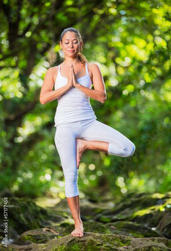 Woman Practacing Yoga in Nature - 57177458