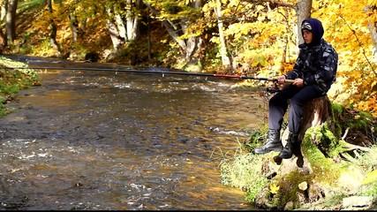 Boy fishing near river in autumn episode 3