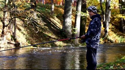 Boy fishing near river in autumn episode 10