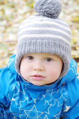 portrait of lovely baby boy outdoors in autumn