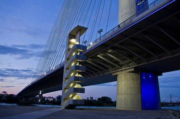 Cable bridge over Sava river at twilight