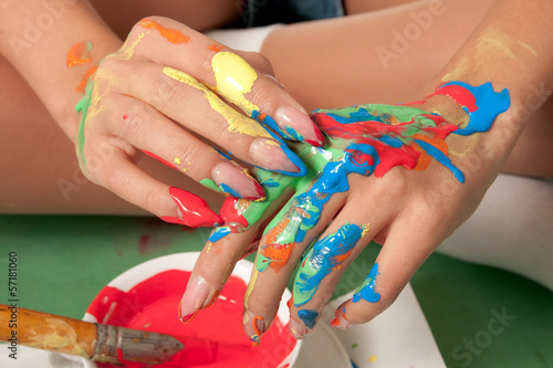 Hands of a girl colored with fresh paint
