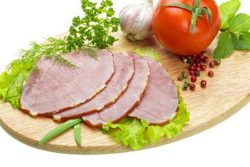 Ripe fresh ham with vegetables