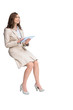Businesswoman holding tablet and looking up