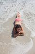 High angle view of woman lying down on beach