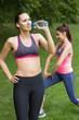 Fit woman wearing sportswear drinking water