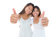 Two pretty young women showing thumbs up