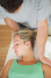 Physiotherapist massaging patients shoulder