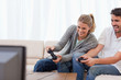 Laughing couple playing video games