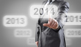 Businessman selects 2014 on touch screen