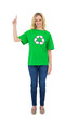 Smiling blonde environmental activist pointing up