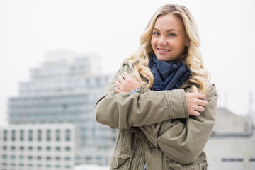 Cold trendy blonde posing outdoors