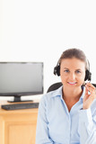 Smiling secretary wearing a headset