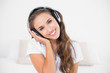 Cheerful attractive brunette listening to music