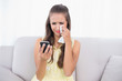 Crying attractive brunette holding mobile phone and tissue