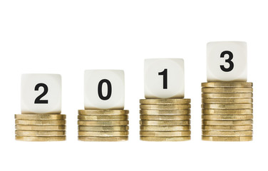 Year 2013 on Stacks of Gold Coins with White Background