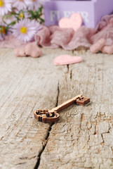 Wooden key with little hearts on Valentine's day