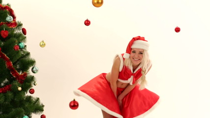 Attractive woman dressed as Santa Claus posing