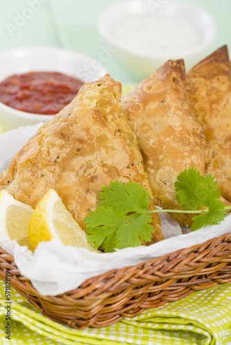 Samosas - Deep fried stuffed pasties with lemon wedges and dips