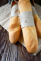 fresh baguettes tied with kraft paper