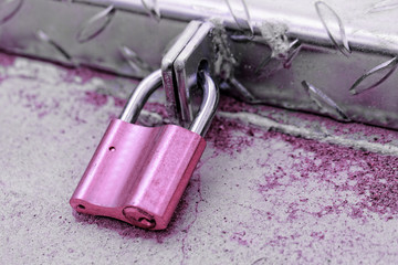 A padlock on an iron door