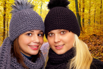 Two young women in autumn