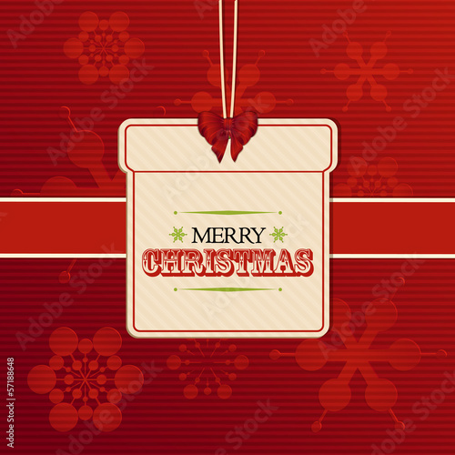 Christmas gift label on red embossed snowflakes