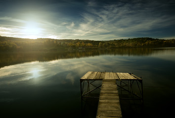 An empty pier, a beautiful lake.