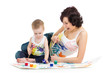 mother wih kid boy drawing and painting together