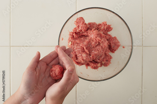 Cook hands making meatballs