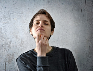 young man with hand on face