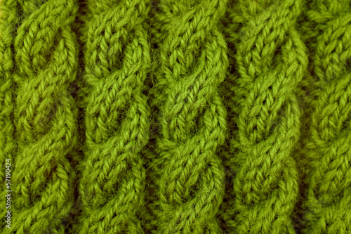 Closeup of green cable knitting stitch