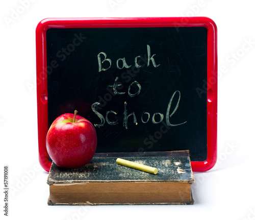 chalkboard, chalks, apple and old book