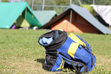 backpack amid the tents of camp during the adventurous excursion
