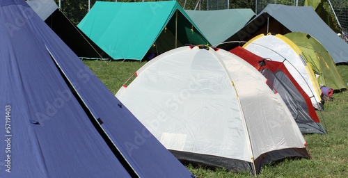 campsite with many tents and shelters for people