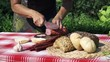 woman cutting a sausage into slices, slow motion shot at 240fps