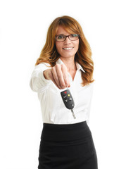 Businesswoman holding up car key