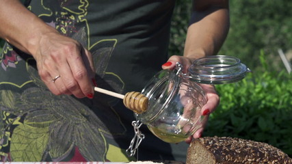 woman pouring honey on the roll, slow motion shot at 240fps
