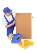 House painter and empty corkboard