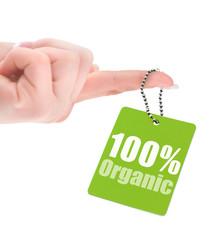 hand holding 100% organic label