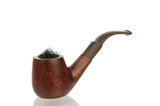 Vintage pipe with tobacco isolated in white