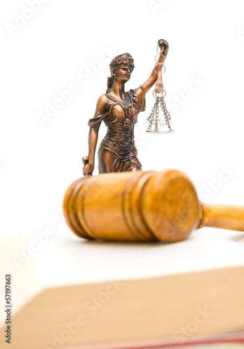 Statue of justice on a white background. vertical photo.