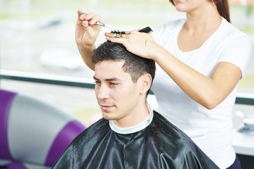 Male hairdresser at work