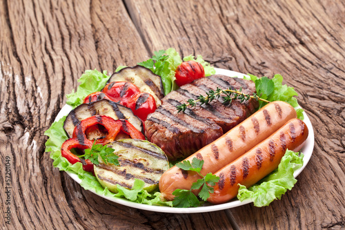 Grilled steak,sausages and vegetables.