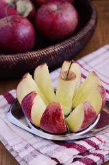Cutting apple with metal cutter