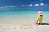 Girl relaxing on the beach of Exuma, Bahamas