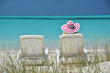 Girl in a striped hat on the beach of Exuma, Bahamas