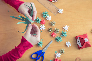 Female hands making Christmas decorations
