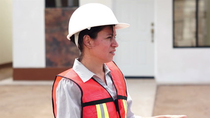 Hispanic Female Foreman Smiling