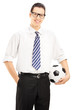 Confident male with tie holding a football